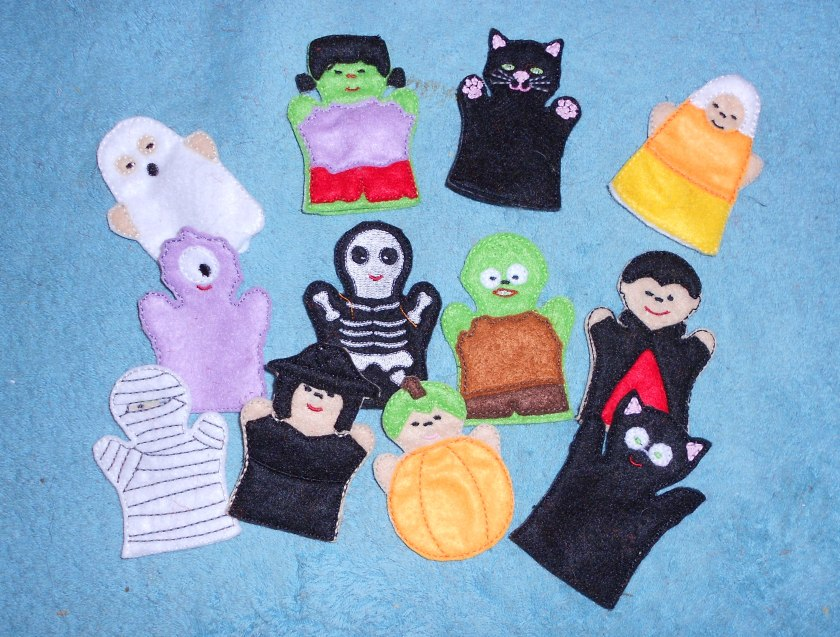 Finger puppets created in the embroidery hoop. Using for Halloween Advent Calender.