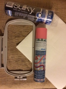 Re-positional Hoop, Temporary Spray Adhesive, Burlap, Tear away Stabilizer for the bottom, Wash away Stabilizer for the top.